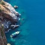 Diving ship at blue sea mountain beach bay